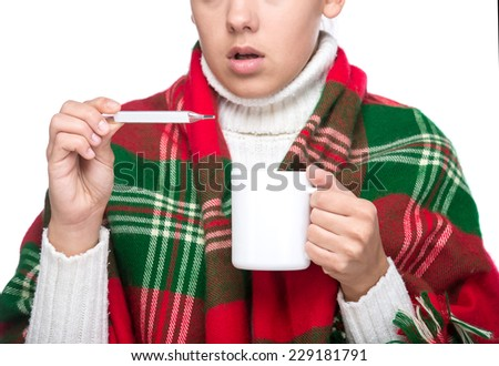 Portrait of young woman is having high temperature and holding a cup of tea. - stock photo