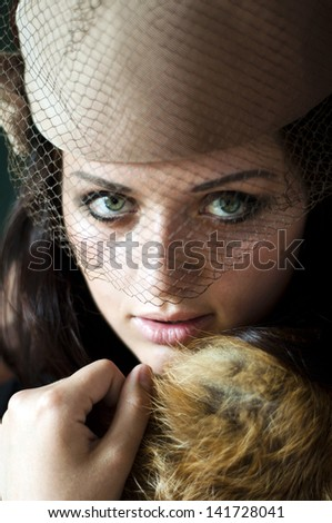 portrait of young woman keeping fur
