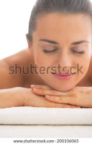 Portrait of young woman laying on massage table