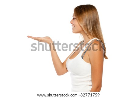 Portrait of young woman looking at a product - empty copy space on the open hand palm, isolated on white background - stock photo