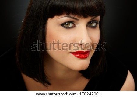 Portrait of young woman looking at camera - stock photo