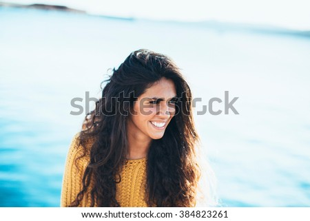 Portrait of young woman looking away while sitting on pier.Summertime - stock photo