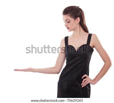 Portrait of young woman looking on her empty hand, isolated on a white. - stock photo