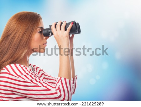 portrait of young woman looking through a binoculars - stock photo