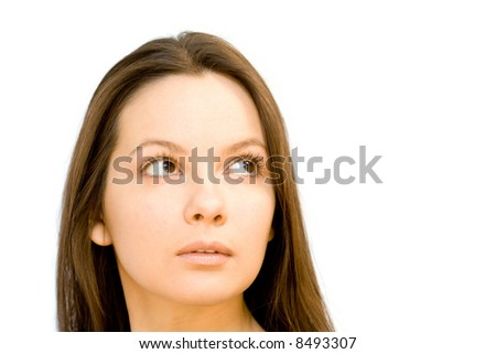Portrait of young woman looking up. Isolated on white background - stock photo