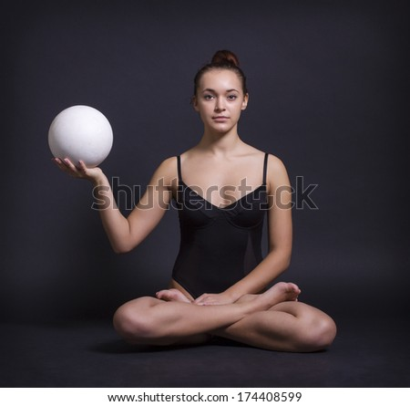 Portrait of young woman meditating in pose of lotus - stock photo