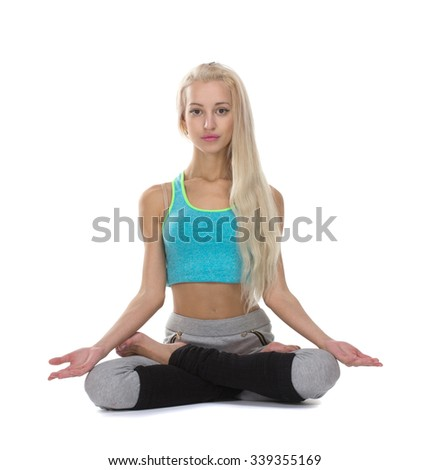 Portrait of young woman meditating in pose of lotus, isolation on white - stock photo