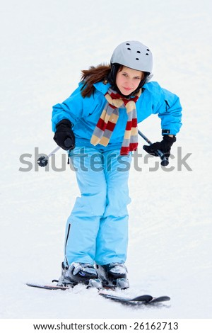 Portrait of young woman on ski resort - stock photo
