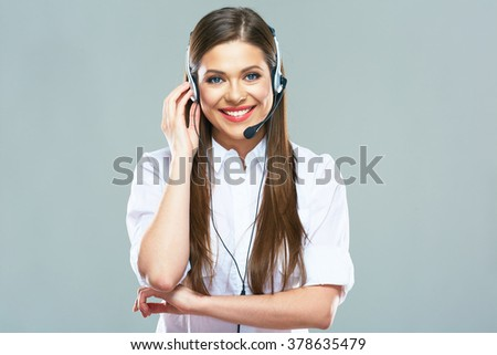 Portrait of young woman operator support center. Studio background isolated. - stock photo