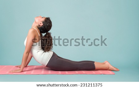 Portrait of young woman performing yoga asana - stock photo