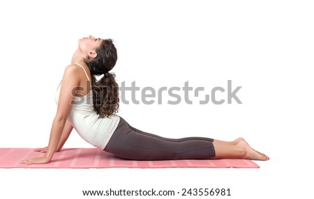 Portrait of young woman performing yoga asana