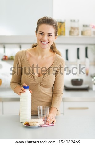 Portrait of young woman ready for breakfast - stock photo