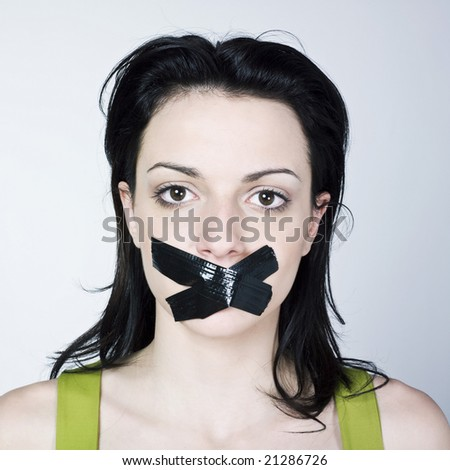 portrait of young woman reduce to silence on isolated background - stock photo