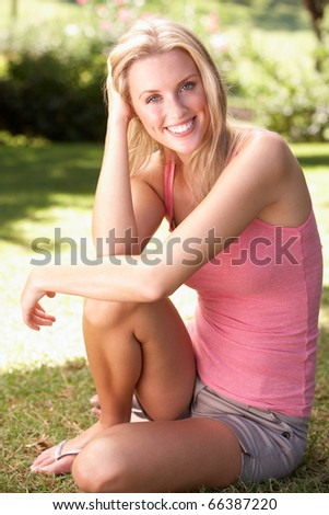 Portrait Of Young Woman Relaxing In Park - stock photo