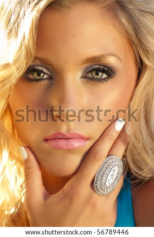 Portrait of young woman's face with beautiful eyes and fashionable antique silver ring.
