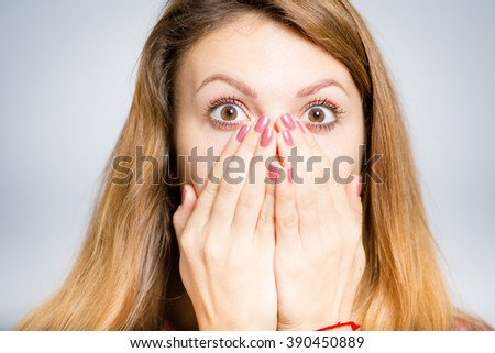portrait of young woman shocked, isolated on a gray background - stock photo