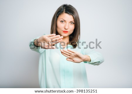 portrait of young woman showing a gesture stop - stock photo