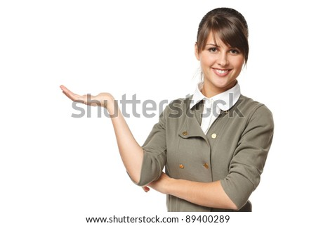 Portrait of young woman showing a product - empty copy space on the open hand palms, over white background - stock photo