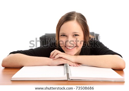 Portrait of young woman sitting at her desk with a smile