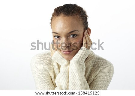 Portrait of young woman smiling in studio