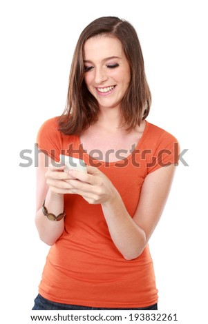 portrait of young woman smiling using mobile phone - stock photo