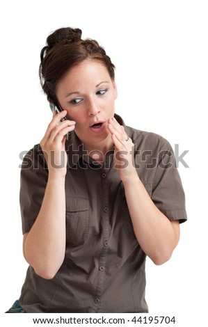 Portrait of young woman telling secret by the cell phone. Isolated over white background. - stock photo