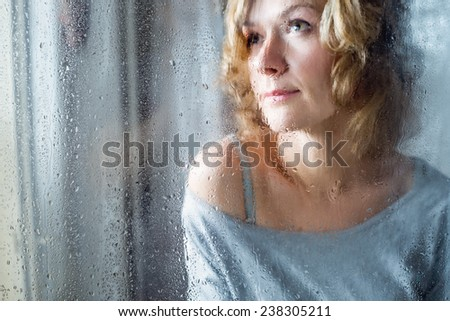 Portrait of Young woman throw the rain drops - stock photo