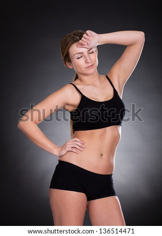 Portrait Of Young Woman Tired After Workout - stock photo