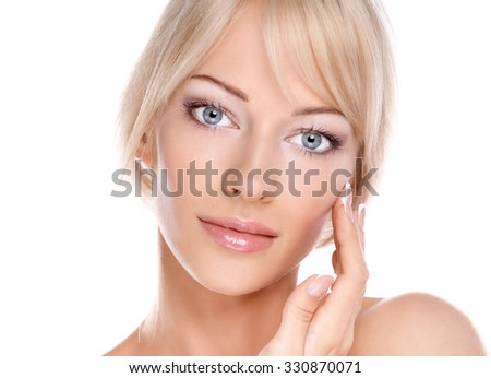 Portrait of young woman touching her face isolated on white background