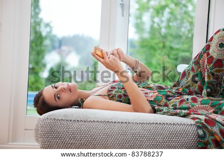 Portrait of young woman using cell phone - stock photo