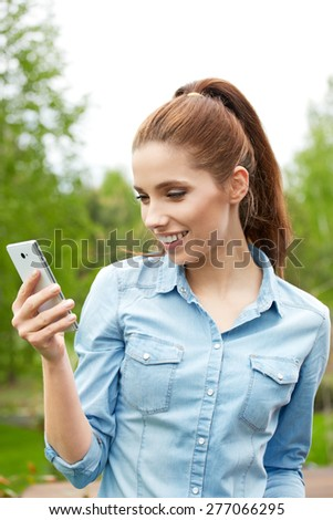 Portrait of young woman using cellphone outdoors