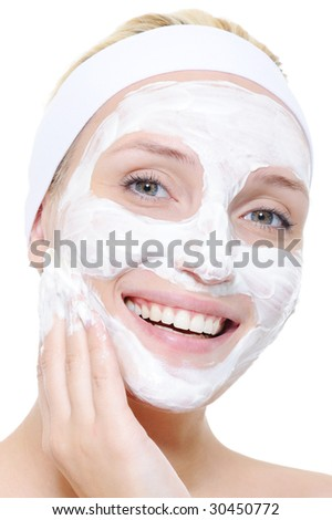 portrait of young woman using cosmetic aids - white background