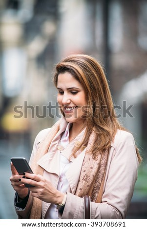 Portrait of young woman using her mobile phone
