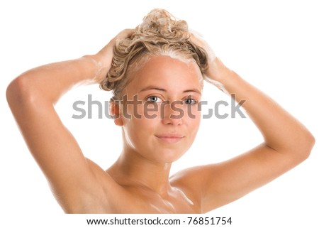 Portrait of young woman washing hair - stock photo