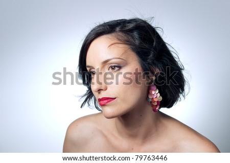 Portrait of young woman wearing earrings - stock photo
