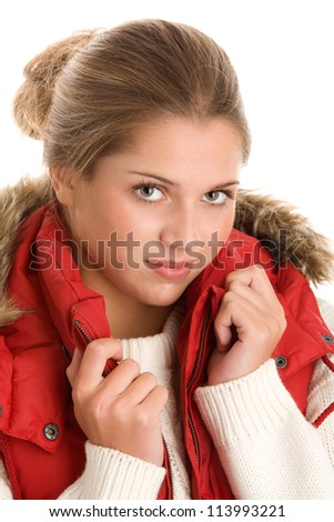 Portrait of young woman wearing warm clothes - stock photo