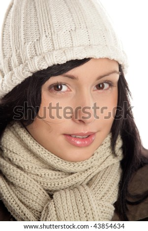 Portrait of young woman wearing woolly scarf and cap
