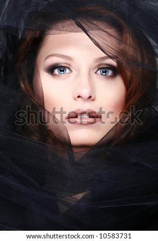 portrait of young woman wiht black scarf - stock photo