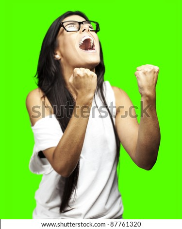 portrait of young woman winning against a removable chroma key background - stock photo