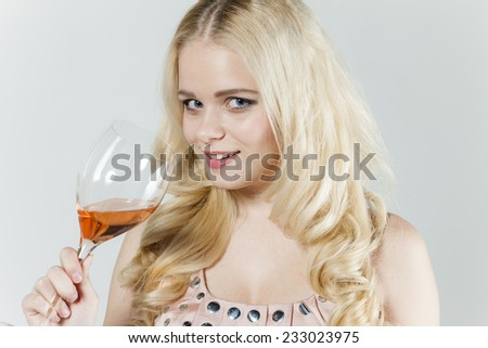 portrait of young woman with a glass of rose wine - stock photo