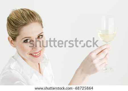 portrait of young woman with a glass of white wine - stock photo