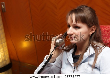 Portrait of young woman with a phone - stock photo