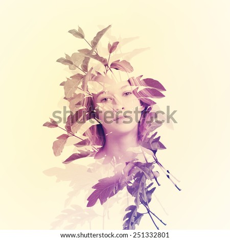 Portrait of young woman with abstract leaves - stock photo