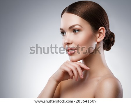 Portrait of young woman with beautiful face and soft skin