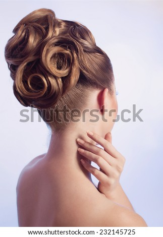 Portrait of young woman with beautiful hair-do - stock photo