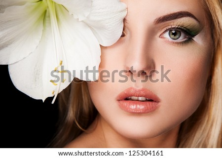 portrait of young woman with big flower - stock photo