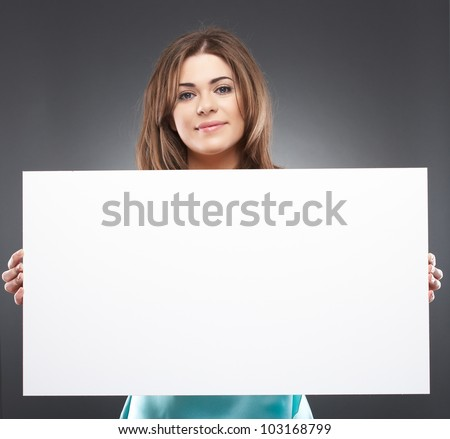 Portrait of young woman with blank white board on gray isolated - stock photo