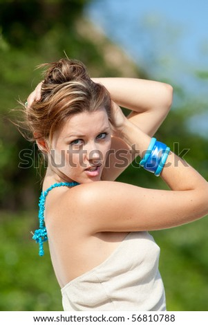 Portrait of young woman with blue accessories outdoors