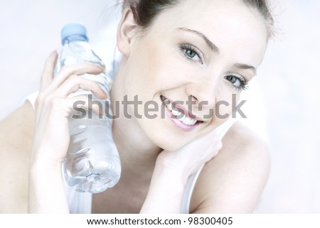 portrait of young woman with bottle - stock photo