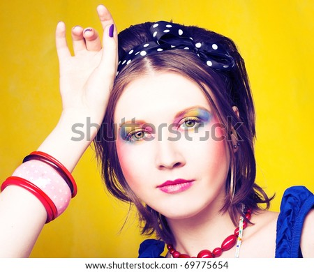 Portrait of young woman with bright visage.